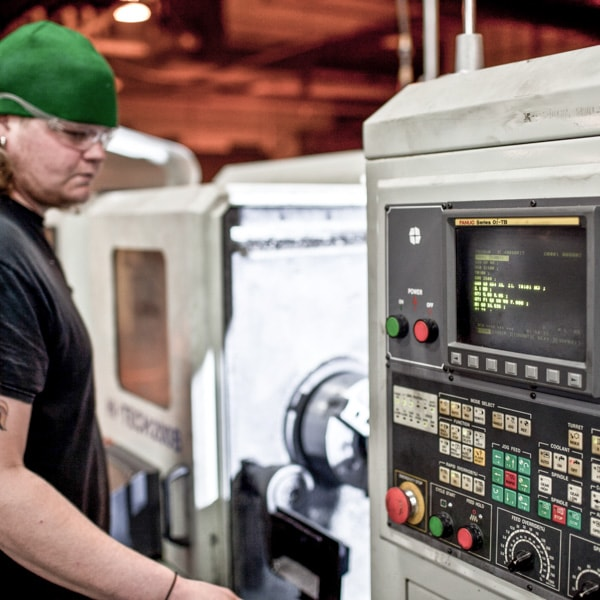 Manufacturing at Anderson Industries on a lathe