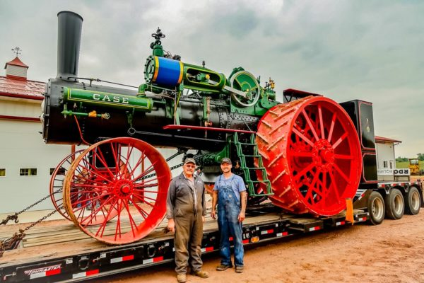 Kory Anderson and Mark Davidson, the truck driver who volunteered his time and costs to haul the brand new 150 HP Case steam traction engine from Gary Bradley's shop in Sheridan, WY (where it was assembled) to its home in Andover, SD.